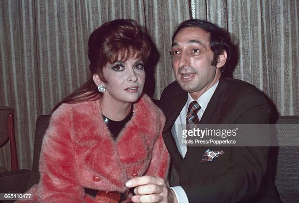 Italian actress Gina Lollobrigida pictured with American businessman George Kaufman in Rome Italy as they prepare to fly to New York on 12th November...