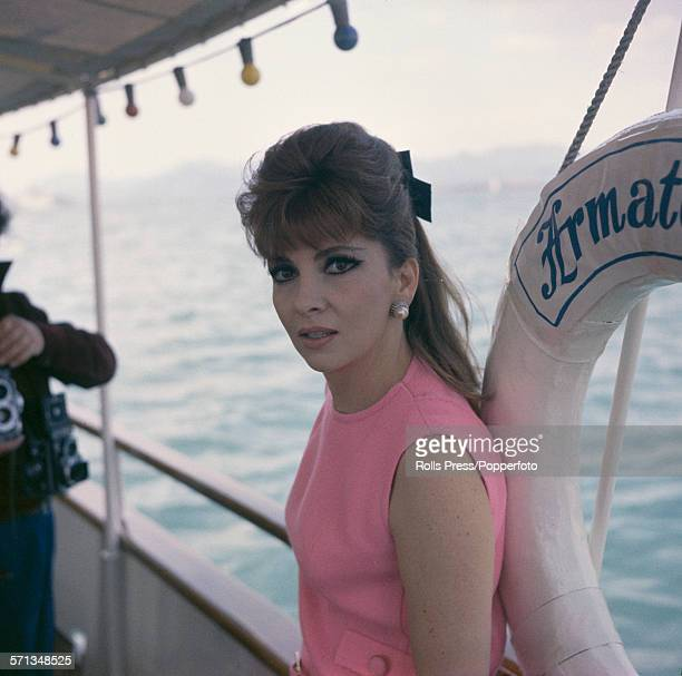 Italian actress Gina Lollobrigida posed wearing a pink sleeveless dress on a yacht at the Cannes film festival in Cannes France in May 1967