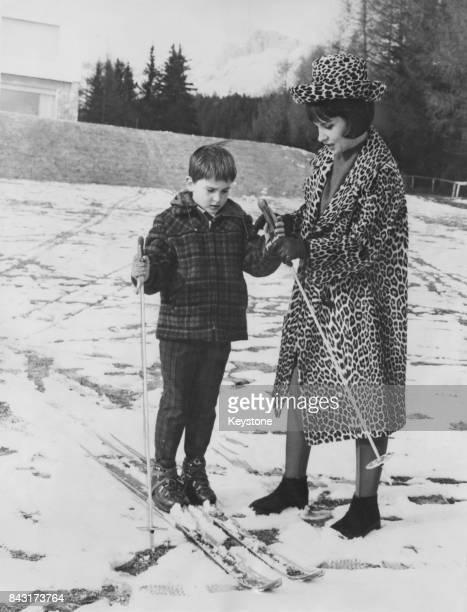 Italian actress Gina Lollobrigida teaching her son Milko Jr how to ski at CranssurSierre Switzerland 24th February 1964
