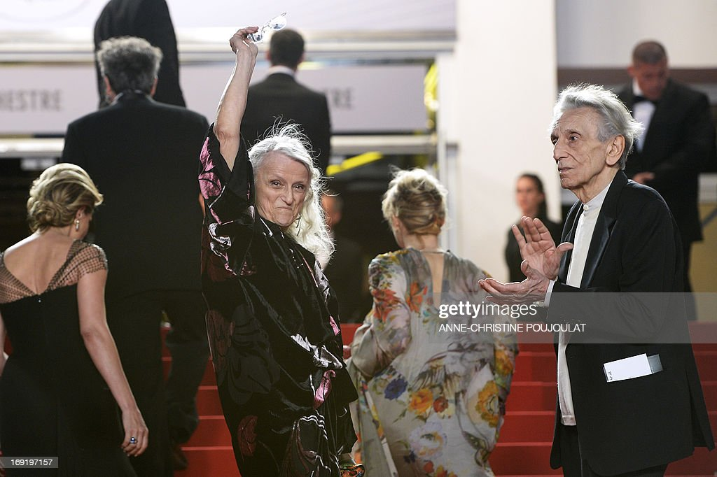 Italian actress Giusi Merli (L) and actor Roberto Herlitzka (R) arrive on May 21, 2013 for the screening of the film 'La Grande Bellezza' (The Great Beauty) presented in Competition at the 66th edition of the Cannes Film Festival in Cannes. Cannes, one of the world's top film festivals, opened on May 15 and will climax on May 26 with awards selected by a jury headed this year by Hollywood legend Steven Spielberg. AFP PHOTO / ANNE-CHRISTINE POUJOULAT