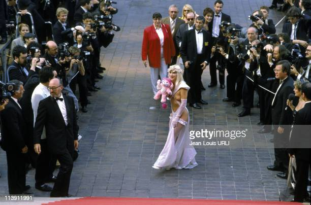 Italian actress Ilona Staller also knwon as La Cicciolina poses on the stairs of the Festival Palace at Cannes Film Festival in Cannes France on May...
