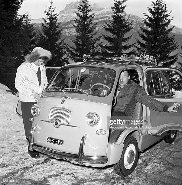 Italian actress Ira von Fuerstenberg in the mountains with her husband Alfonso di HohenloheLangenburg Cortina 1956