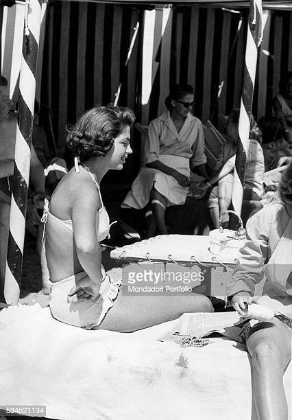 Italian actress Ira von Furstenberg wearing a bikini sitting on a deckchair of Hotel Excelsior In Venice the 18th International Film Festival is...