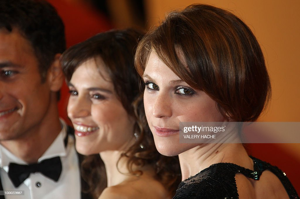 Italian actress Isabella Ragonese (R) arrives for the screening of 'La Nostra Vita' (Our Life) presented in competition at the 63rd Cannes Film Festival on May 20, 2010 in Cannes.