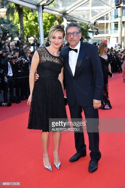 Italian actress Italian actress Jasmine Trinca and Italian actor and director Sergio Castellitto pose as they arrive on May 27 2017 for the screening...