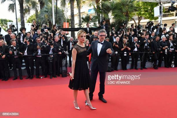 Italian actress Jasmine Trinca and Italian director Sergio Castellitto pose as they arrive on May 27 2017 for the Un Certain Regard prize ceremony at...