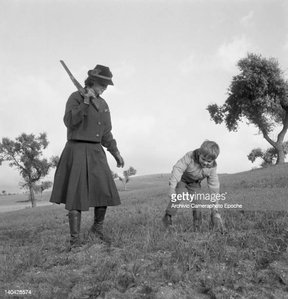 Italian actress Lucia Bose and her son Miguel Bose portrayed while picking up a dead partridge during a hunting trip Madrid 1961