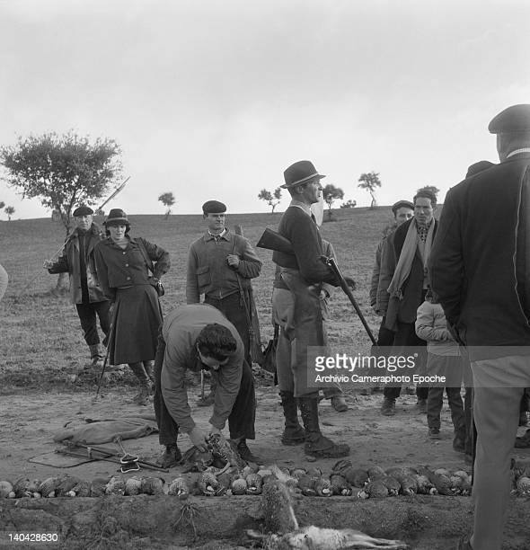 Italian actress Lucia Bose checking the the partridges on the floor Madrid 1961