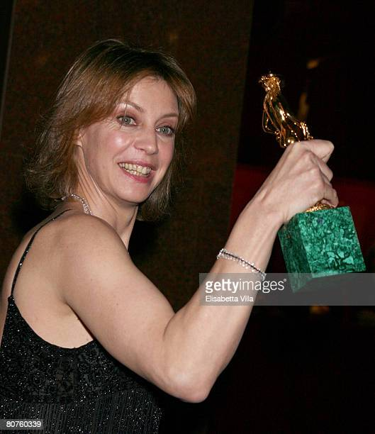 Italian actress Margherita Buy shows her award for Best Actress during the Italian Movie Awards ''David Di Donatello'' at the Auditorium...