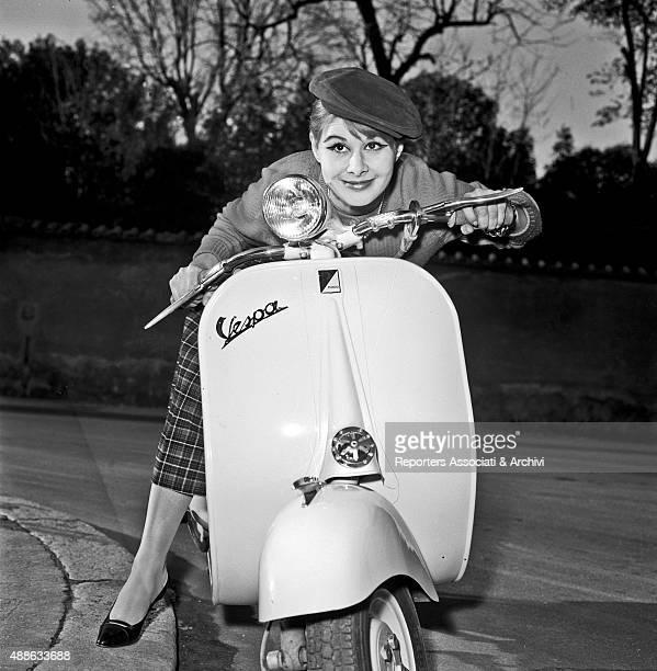 Italian actress Marisa Allasio posing on a Vespa Rome 1958