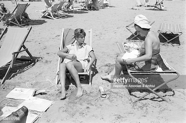 Italian actress Marisa Allasio relaxing at the beach with her mother Versilia 1960