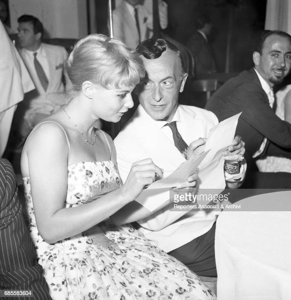 Italian actress Marisa Allasio with famous dressmaker Emilio Federico Schuberth during the beauty pageant 'Miss Belvedere delle Rose' in the Roman...