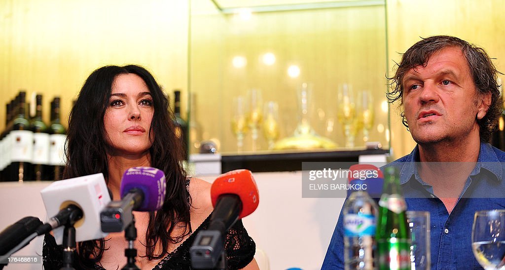 Italian actress Monica Bellucci (L) and Bosnian-born film director Emir Kusturica (R) answer journalists' questions during a press conference in the southern Bosnian town of Trebinje, on August 13, 2013. Bellucci plays a title female role in the newest film by Kusturica, 'On the Milky Road', being currently shot in southern Bosnia.