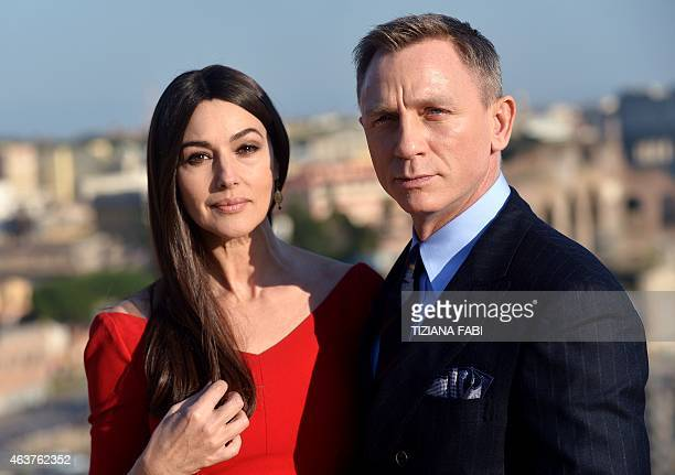 Italian actress Monica Bellucci and British actor Daniel Craig pose during a photocall to promote the 24th James Bond film 'Spectre' on February 18...