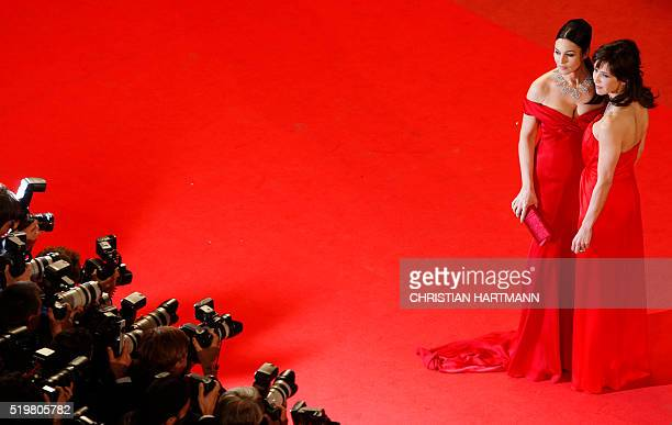 Italian actress Monica Bellucci and French actress Sophie Marceau pose while arriving for the screening of the movie 'Ne Te Retourne Pas' out of...