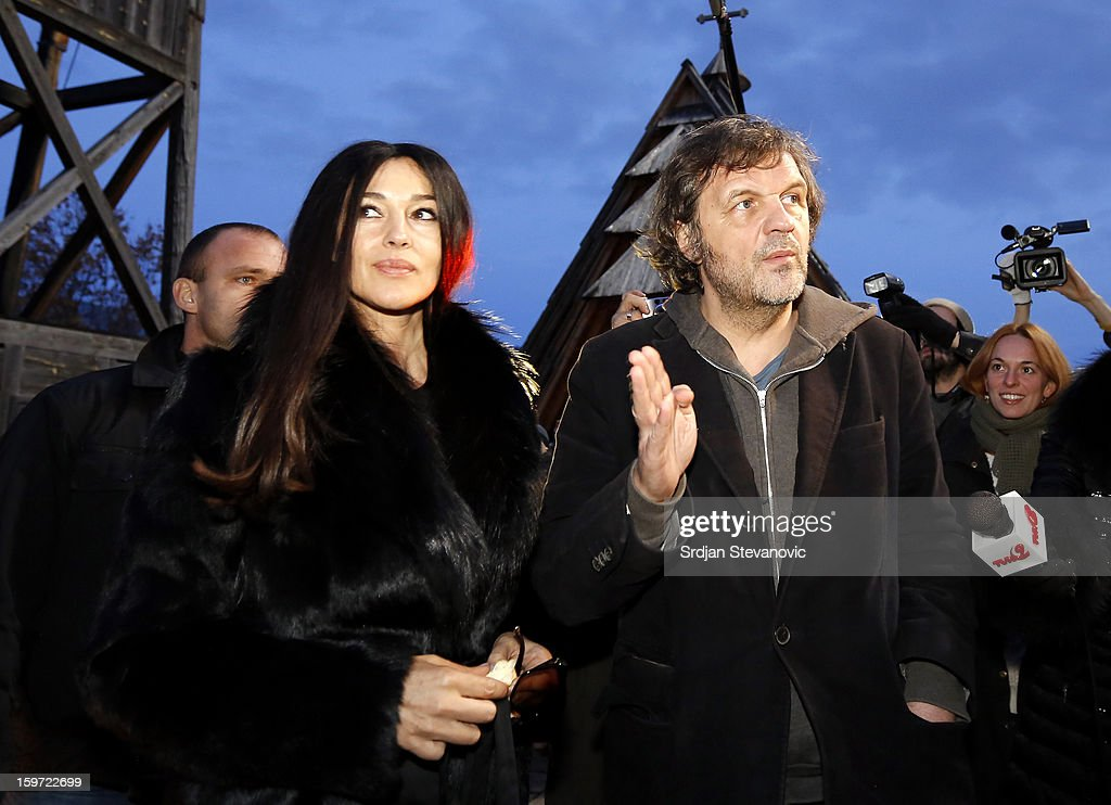 Italian actress <a gi-track='captionPersonalityLinkClicked' href=/galleries/search?phrase=Monica+Bellucci&family=editorial&specificpeople=204777 ng-click='$event.stopPropagation()'>Monica Bellucci</a> and Serbian film director <a gi-track='captionPersonalityLinkClicked' href=/galleries/search?phrase=Emir+Kusturica&family=editorial&specificpeople=210555 ng-click='$event.stopPropagation()'>Emir Kusturica</a> (L) visit Visegrad before heading to the Kustendorf Film Festival being held in Drvengrad, Serbia on January 19, 2013 in Visegrad, Bosnia and Herzegovina.