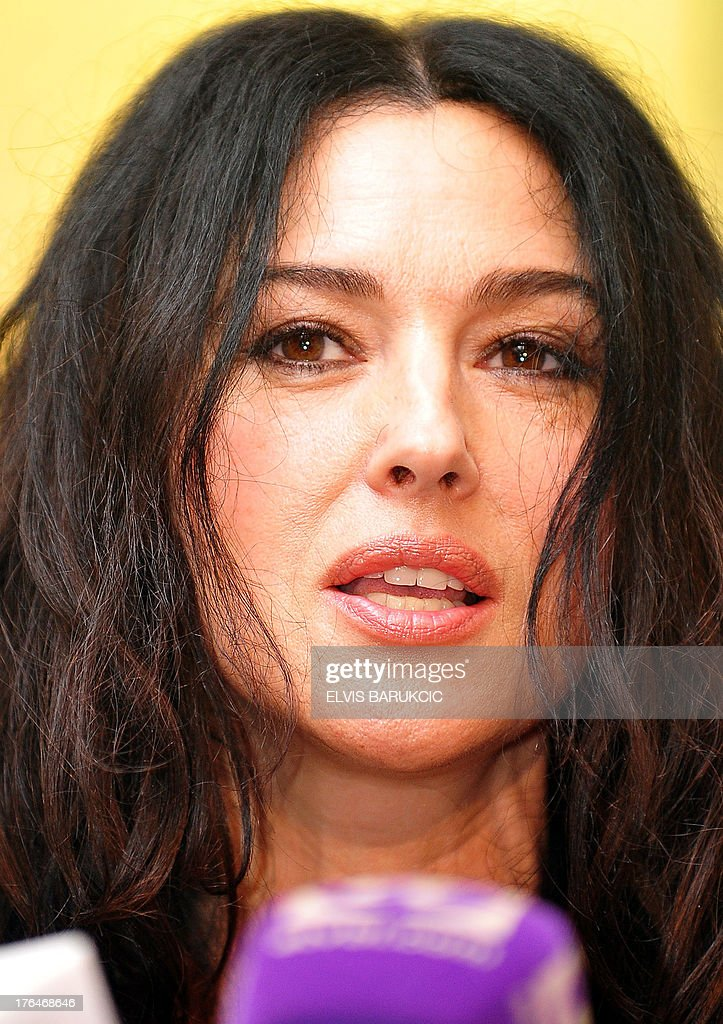 Italian actress Monica Bellucci answers journalists' questions during a press conference in the southern Bosnian town of Trebinje, on August 13, 2013. Bellucci plays a title female role in the newest film by Bosnian-born film director Emir Kusturica, 'On the Milky Road', being currently shot in southern Bosnia.