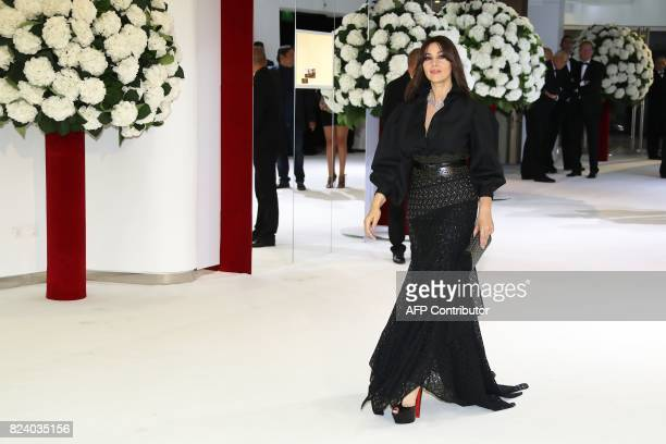 Italian actress Monica Bellucci arrives for the Rose Ball at the MonteCarlo Sporting Club in Monaco during the 69th annual Red Cross Gala on July 28...