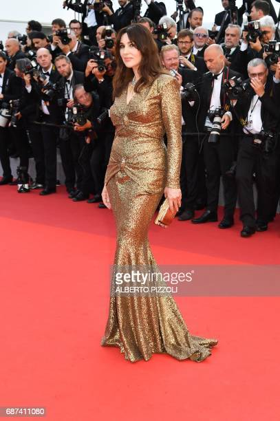 Italian actress Monica Bellucci poses as she arrives on May 23 2017 for the '70th Anniversary' ceremony of the Cannes Film Festival in Cannes...