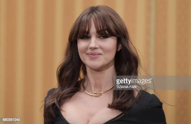 Italian actress Monica Bellucci poses during a photocall of the movie 'Milky Road' directed by Emir Kusturica on May 8 2017 in Rome / AFP PHOTO /...