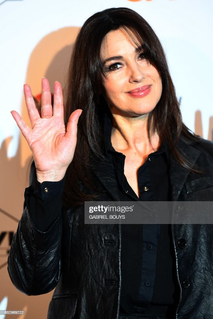 Italian actress Monica Bellucci poses during the photocall for the premiere of the film 'Chacun Sa Vie' in Paris on March 13, 2017. The film is directed by French director Claude Lelouch. /