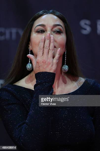 Italian actress Monica Bellucci sends a kiss to audience during the red carpet of the 'Spectre' film Premiere at Auditorio Nacional on November 02...