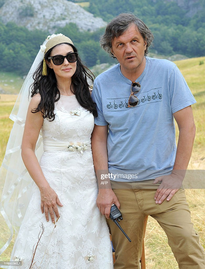 Italian actress Monica Bellucci (L) stands with internationally acclaimed Serbian director Emir Kusturica on the set of his new movie entitled 'The Milky Road', near the town of Gacko, southeastern Bosnia on August 14, 2013. Bellucci has started filming for the new movie 'The Milky Road', expected to be presented in Cannes in 2014. AFP PHOTO / MILOS CVETKOVIC OUT--