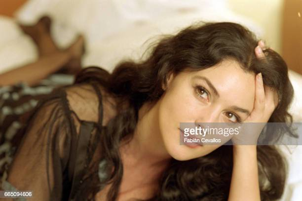 Italian actress Monica Bellucci with her hand in her hair takes a break in her dressing room from the shooting of the Italian director Giuseppe...