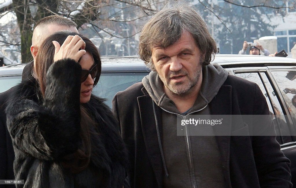 Italian actress Monica Belluci (L) and Bosnian born film director, Emir Kusturica (R), arrive for a meeting with Bosnian Serb officials in Western-Bosnian town of Banja Luka on January 19, 2013. Accompanied by Kusturica, Belluci visited Banja Luka and Eastern Bosnian town of Visegrad, on her way to Mecavnik in Serbia, where 2013 issue of Kusturica's film festival 'Kustendorf' has opened on January 17. AFP PHOTO /STR