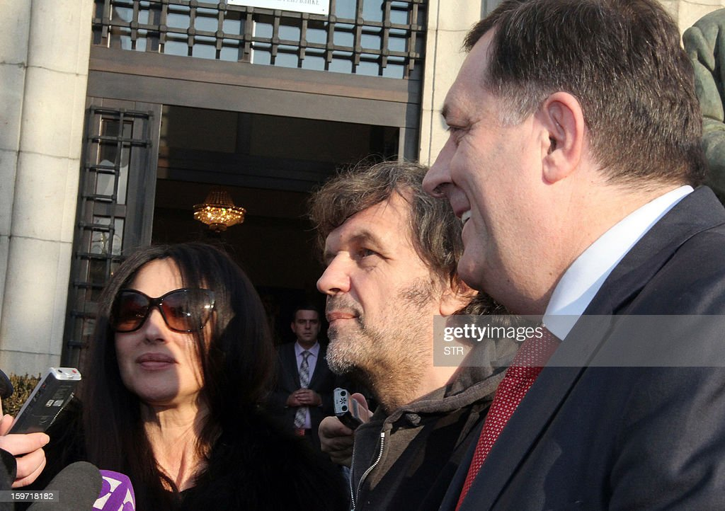 Italian actress Monica Belluci (L) and Bosnian born film director, Emir Kusturica (C), address media as they are greeted by Milorad Dodik (R) prior to a meeting with Bosnian Serb officials in the Western-Bosnian town of Banja Luka, on January 19, 2013. Accompanied by Kusturica, Belluci visited Banja Luka and the Eastern Bosnian town of Visegrad, on her way to Mecavnik in Serbia, where Kusturica's film festival 'Kustendorf' opened on January 17.