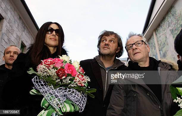 Italian actress Monica Belluci and Bosnianborn film director Emir Kusturica walk through the center of the eastern Bosnian town of Visegrad on...