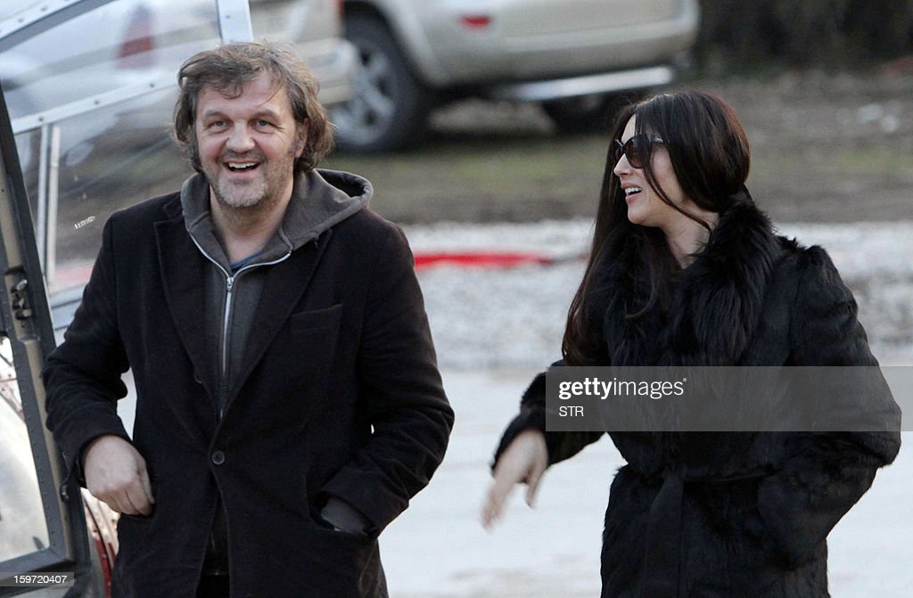 Italian actress Monica Belluci (R) shares a joke with Bosnian born film director Emir Kusturica as they walk through the center of the eastern Bosnian town of Visegrad, on January 19, 2013. Accompanied by Kusturica, Belluci visited Visegrad and the western Bosnian town of Banja Luka, on her way to Mecavnik in Serbia, where Kusturica organizes an annual 'Kustendorf' film festival.