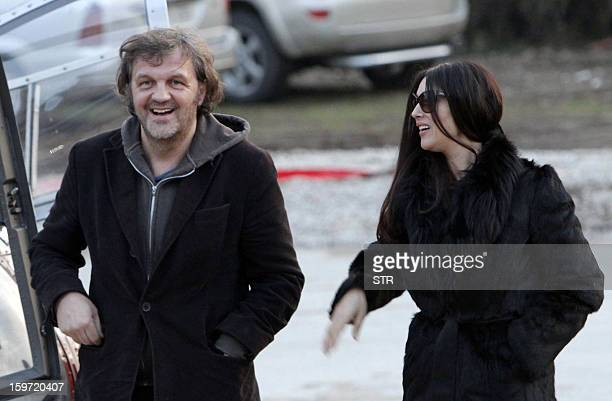 Italian actress Monica Belluci shares a joke with Bosnian born film director Emir Kusturica as they walk through the center of the eastern Bosnian...