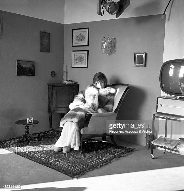 Italian actress Monica Vitti sitting on an armchair wearing a fur in the film Red Desert Italy 20th February 1962