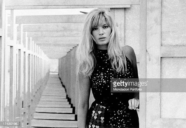 Italian actress Monica Vitti stage name of Maria Luisa Ceciarelli with her chin on her hand looks at the camera smiling Italy 1971