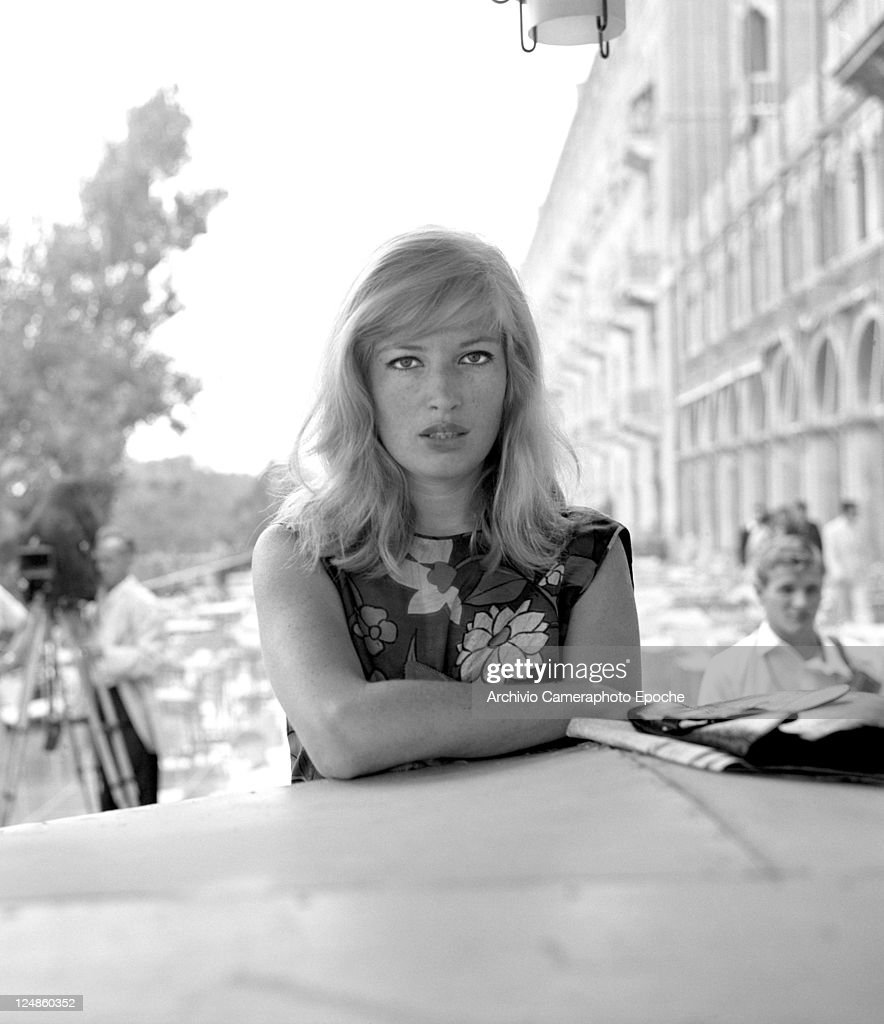 Italian actress Monica Vitti wearing a floral dress portrayed outside the Excelsior Hotel Lido Venice 1964