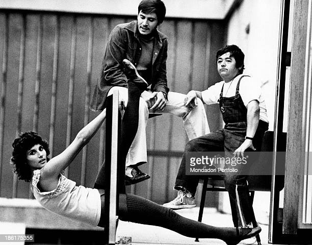 Italian actress Paola Pitagora in leotard and dance shoes working out at the barre on the set of the musical Jacopone Italian actor and singer Gianni...