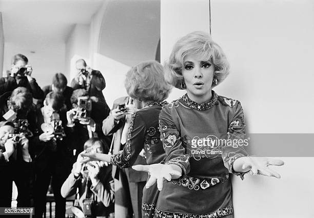 Italian actress photojournalist and sculptor Gina Lollobrigida poses for photographers at the Savoy Hotel London 5th January 1970