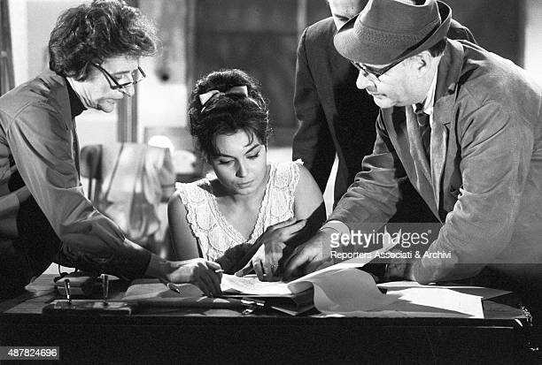 Italian actress Rosanna Schiaffino and Italian director Roberto Rossellini reading the script on the set of the film Rogopag segment Chastity 1963