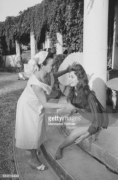 Italian actress Rosanna Schiaffino combed by her mother during the XVIII Venice International Film Festival Venice 1957