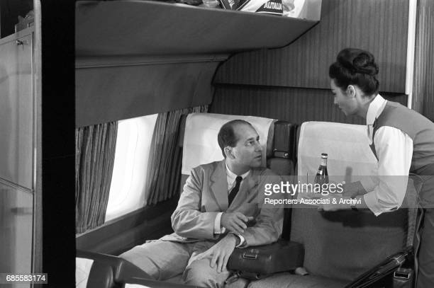 Italian actress Rosanna Schiaffino in the role of hostess serving a drink to a passenger in the film Rogopag segment Chastity directed by Roberto...