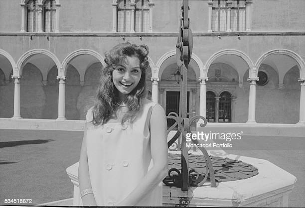 Italian actress Rosanna Schiaffino smiling beside the fountain in the middle of the cloister during the 19th Venice International Film Festival...