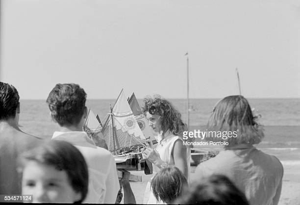 Italian actress Rosanna Schiaffino with a toy boat during the XVIII Venice International Film Festival Venice 1957