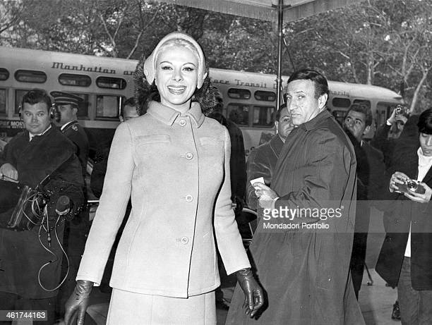 Italian actress Sandra Milo born Salvatrice Elena Greco smiles radiantly at the camera under the amazed eyes of the reporters and the passersby on...