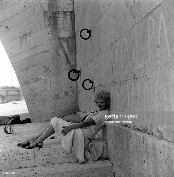 'Italian actress Sandra Milo Elena Liliana Salvatrice Greco's stage name poses leaning herself against the wall of the Tiber Waterfront during a...