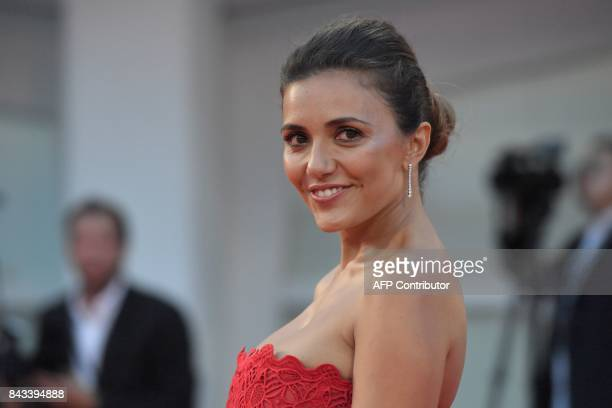 Italian actress Serena Rossi attends the premiere of the movie 'Ammore E Malavita' presented in competition at the 74th Venice Film Festival on...