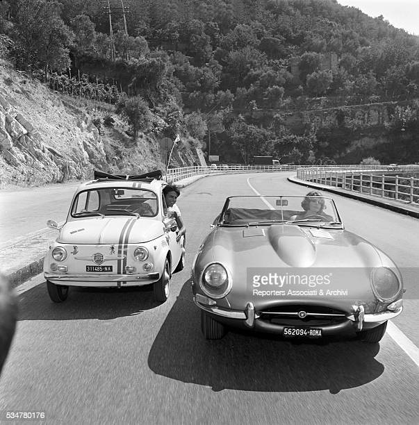 Italian actress Silva Koscina and French actor Jean Sorel driving in Made in Italy Italy 1965