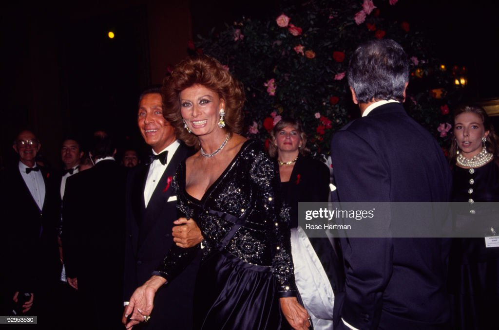 Italian actress <a gi-track='captionPersonalityLinkClicked' href=/galleries/search?phrase=Sophia+Loren&family=editorial&specificpeople=94097 ng-click='$event.stopPropagation()'>Sophia Loren</a>, accompanied by the fashion designer Valentino (born Valentino Clemente Ludovico Garavani), attends the '30 Years of Valentino' gala held at the 67th Street Armory, New York, New York, September 22, 1992.