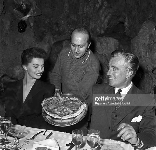 Italian actress Sophia Loren and director Vittorio De Sica celebrating the end of the working of their film 'The Gold of Naples' at the Vesuvio...