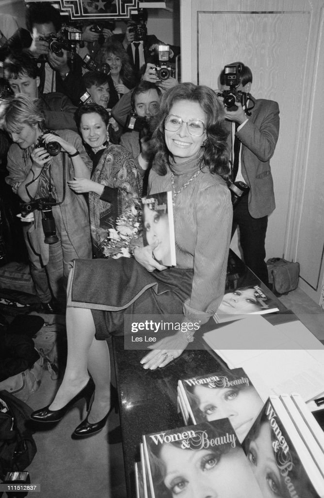 Italian actress <a gi-track='captionPersonalityLinkClicked' href=/galleries/search?phrase=Sophia+Loren&family=editorial&specificpeople=94097 ng-click='$event.stopPropagation()'>Sophia Loren</a> at the launch of her book 'Women and Beauty', 23rd October 1984.